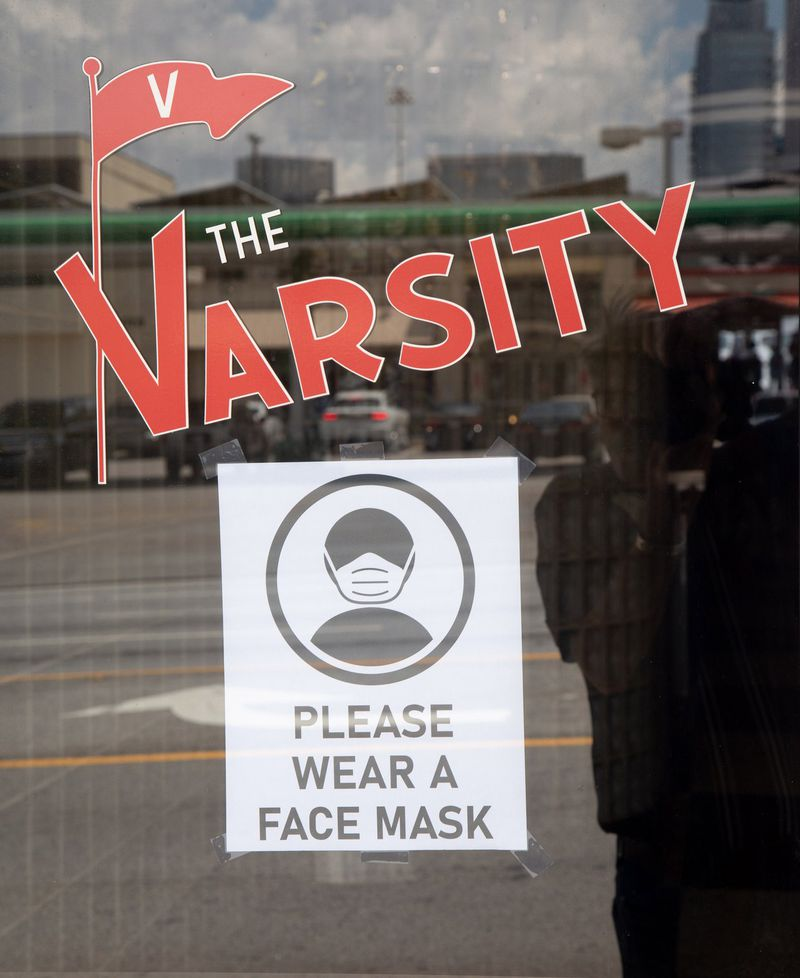 A sign is posted on the door of the Varsity. STEVE SCHAEFER FOR THE ATLANTA JOURNAL-CONSTITUTION