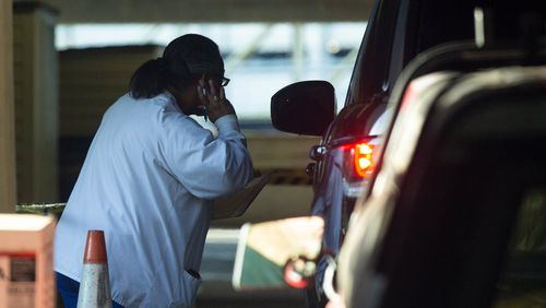 Nurses assist visitors coming for COVID-19 tests at a drive-thru testing center at the Atlanta VA Medical Center in Decatur on Thursday, July 2, 2020. Staff have raised health concerns for patients and other staff, fearing exposure to the virus through lax protective procedures. (REBECCA WRIGHT FOR THE AJC)