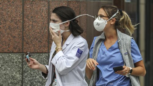 Medical workers arrive at Grady Hospital in downtown Atlanta on Thursday, July 9, 2020. Local hospitals are seeing a surge in new patients as cases reach record highs in Georgia. JOHN SPINK/JSPINK@AJC.COM